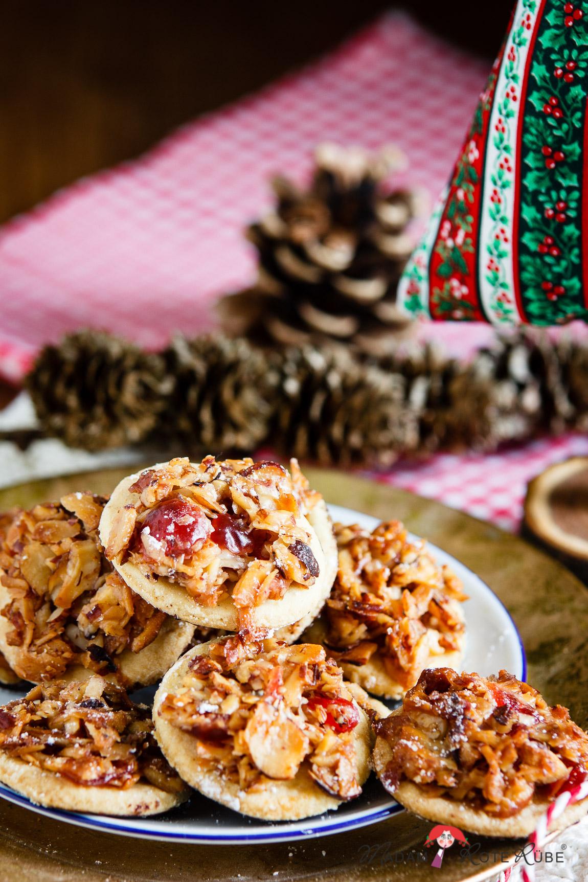 Florentiner Weihnachtsplätzchen.Florentiner Plätzchen Mit Schokoladenfüßchen
